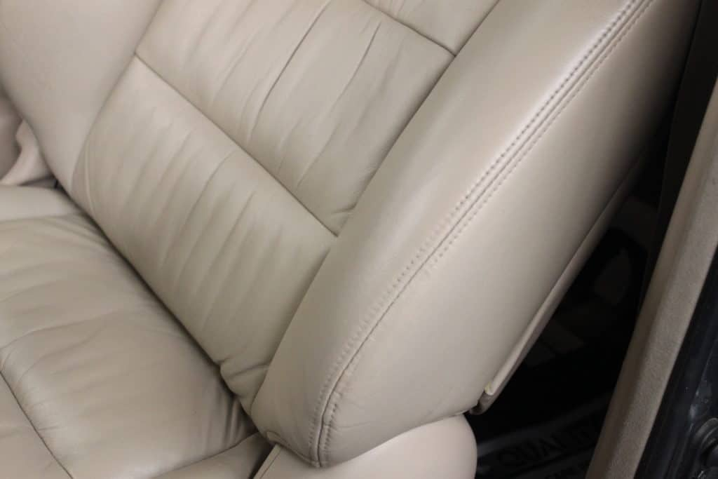 Leather restoration 'after' photo of a cream leather car seat